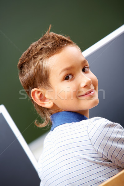 Exitoso chico retrato cute mirando cámara Foto stock © pressmaster