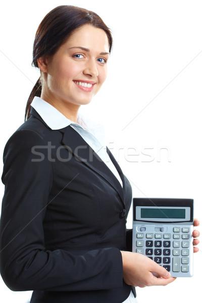 Könyvelő portré üzletasszony számológép néz kamera Stock fotó © pressmaster