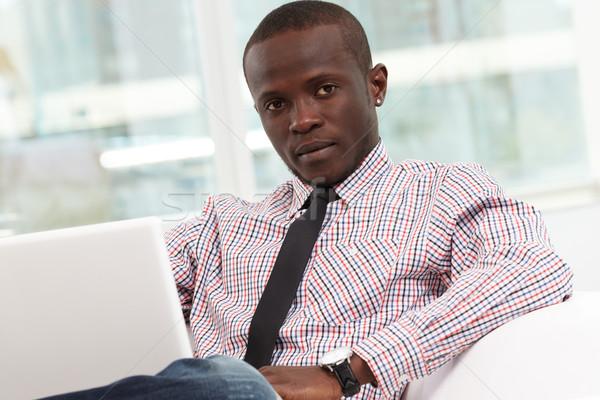 Oficinista imagen jóvenes exitoso empresario sesión Foto stock © pressmaster