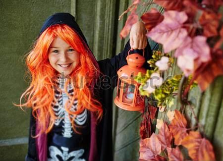 Truque retrato halloween menina lanterna Foto stock © pressmaster
