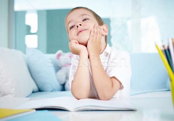 Pensive lad cute garçon séance table Photo stock © pressmaster