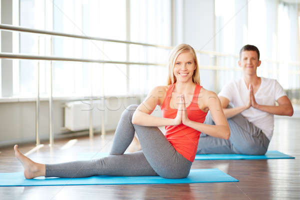 Couple practicing yoga Stock photo © pressmaster