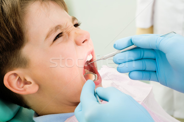 Inspection of oral cavity Stock photo © pressmaster