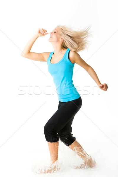 Dinamizmus portré szőke női nevet csobbanás Stock fotó © pressmaster