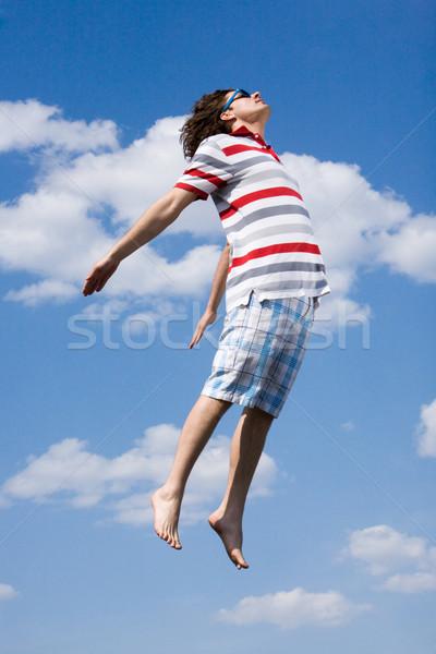Lucht portret energiek man hoogspringen heldere Stockfoto © pressmaster