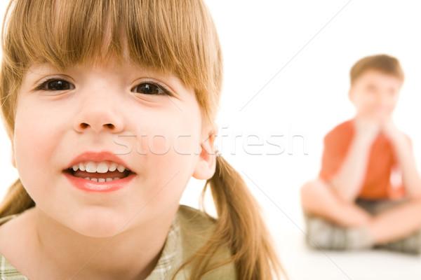 Kicsi cuki arc kicsi lány néz Stock fotó © pressmaster