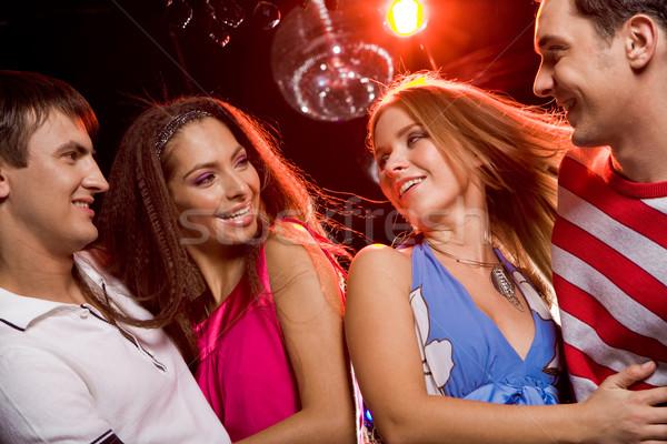Kettő izgatott párok néz egyéb mosoly Stock fotó © pressmaster