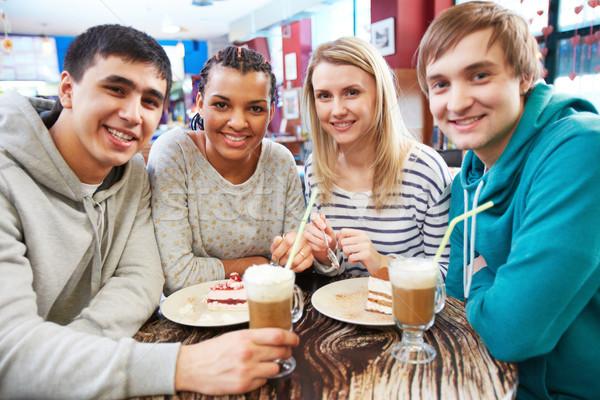 Gathered in cafe Stock photo © pressmaster