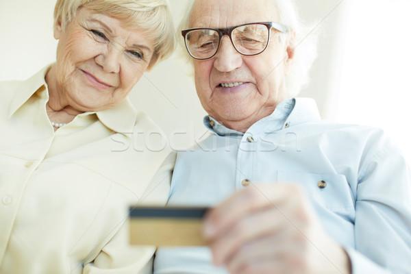 Senior couple with card Stock photo © pressmaster