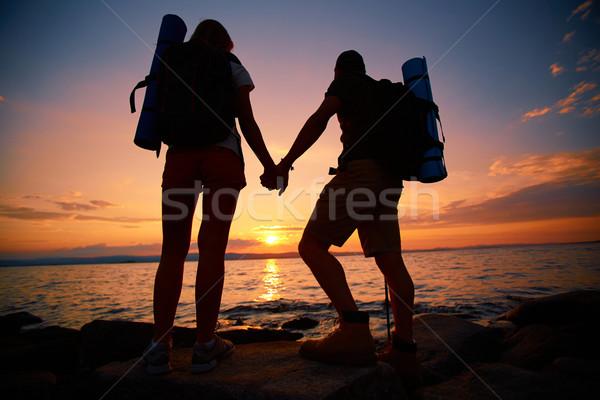 Hikers at sunset Stock photo © pressmaster