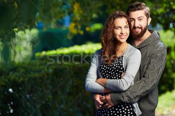 единения изображение счастливым пару глядя камеры Сток-фото © pressmaster