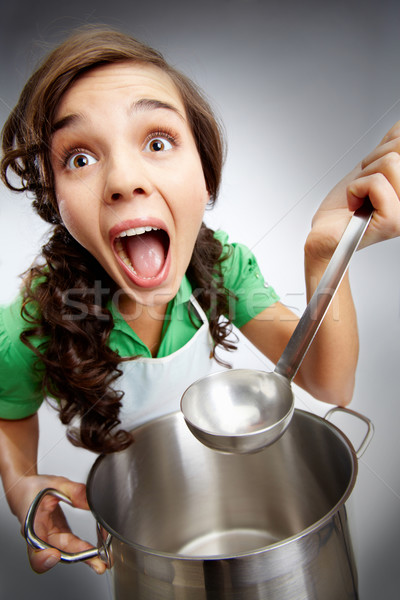 Girl with a ladle Stock photo © pressmaster