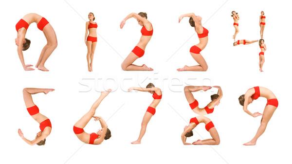 Dígitos imagem jovem posições olhando Foto stock © pressmaster