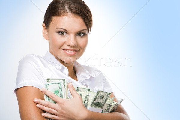 Woman holding money  Stock photo © pressmaster