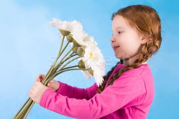 Admiring flowers Stock photo © pressmaster