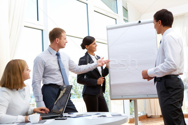 Stratégie d'entreprise affaires groupe de travail discussion nouvelle projet Photo stock © pressmaster