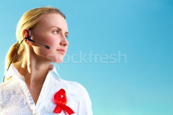 Forródrót recepciós portré csinos nő headset vörös szalag Stock fotó © pressmaster