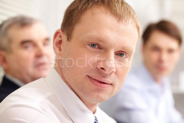 Ambicioso empresário primeiro plano olhando homem reunião Foto stock © pressmaster