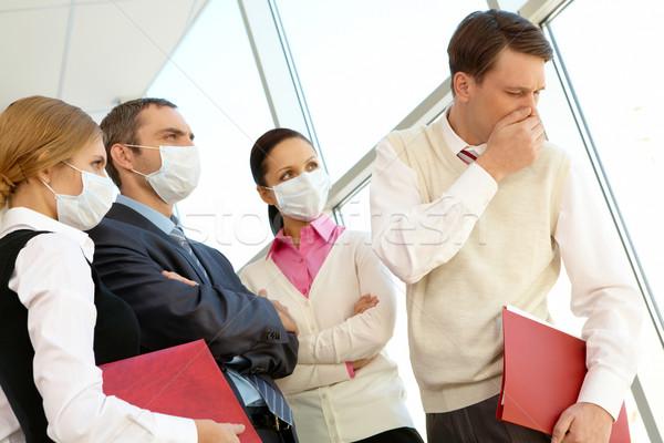 Hoş olmayan semptom grup maskeler bakıyor Stok fotoğraf © pressmaster