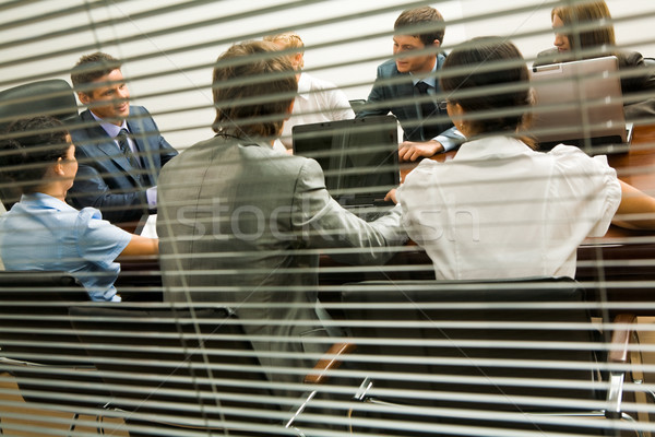 Groep achter jaloezie werken Stockfoto © pressmaster