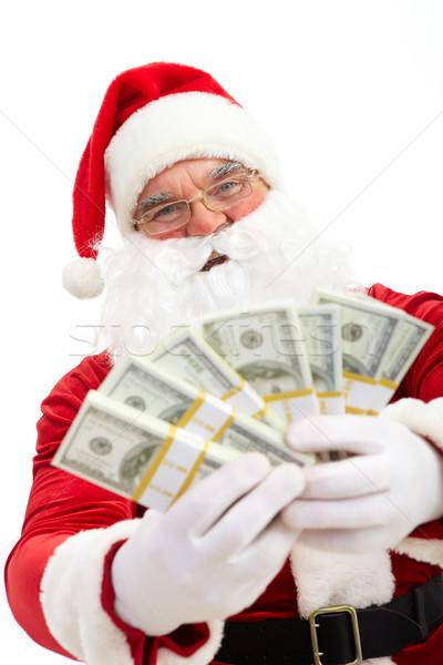 Santa with dollars Stock photo © pressmaster