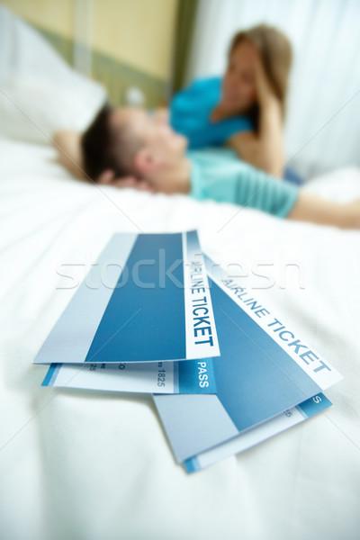 Tickets on bed Stock photo © pressmaster