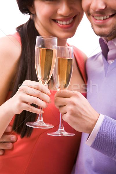 Pareja flautas retrato feliz champán Foto stock © pressmaster
