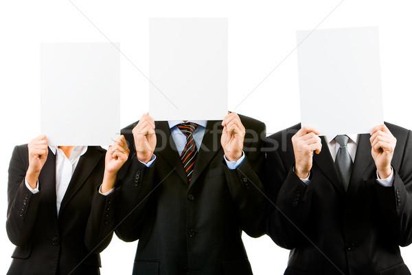 Foto stock: Anuncio · tres · ocultación · caras