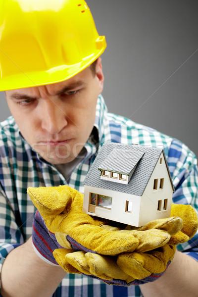 Stock fotó: építkezés · portré · komoly · építész · tart · ház