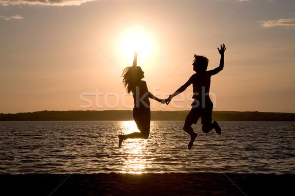 Сток-фото: счастье · счастливым · пару · прыжки · озеро
