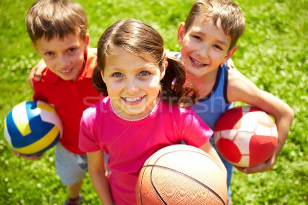 Fiatal futball játékosok portré három kicsi Stock fotó © pressmaster
