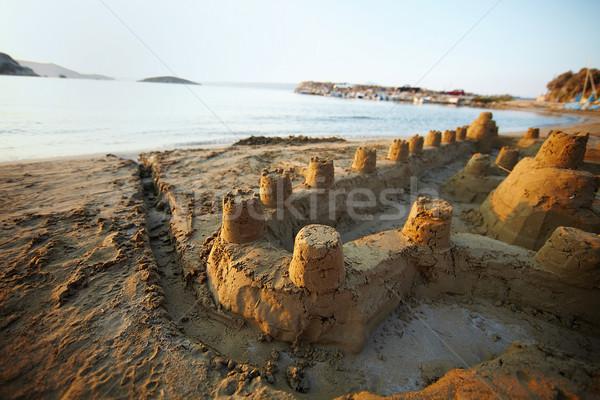 Fortaleza arena pie playa luz puesta de sol Foto stock © pressmaster