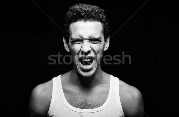 Schreeuw portret knap vent vest schreeuwen Stockfoto © pressmaster