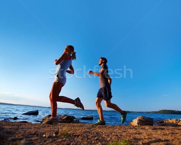 Running on the beach Stock photo © pressmaster