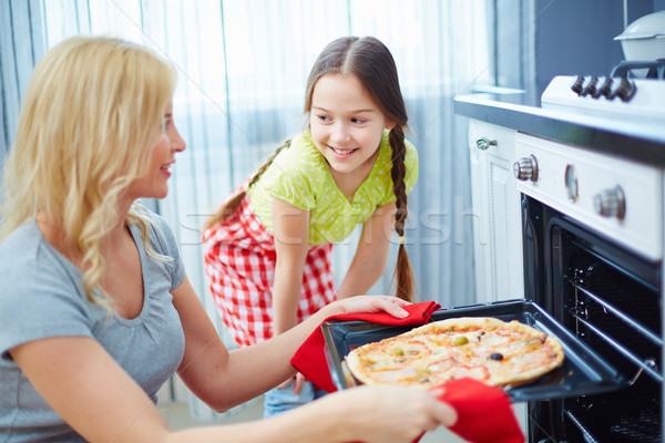 Cottura cena ritratto pizza Foto d'archivio © pressmaster