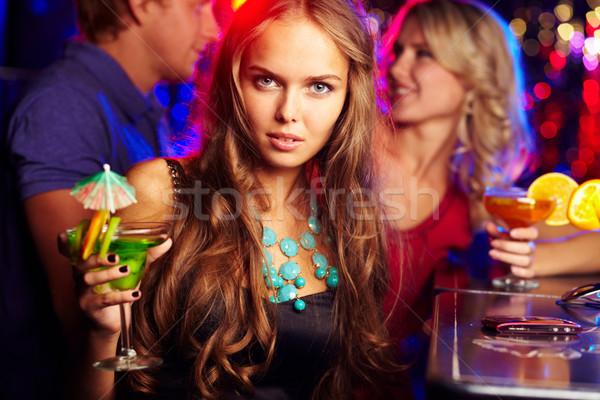 Lány bár kép boldog lány néz kamera Stock fotó © pressmaster