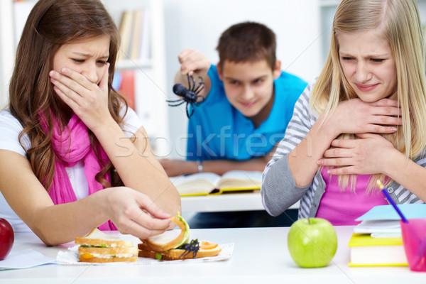 Iğrenme iki kızlar bakıyor örümcek bir Stok fotoğraf © pressmaster