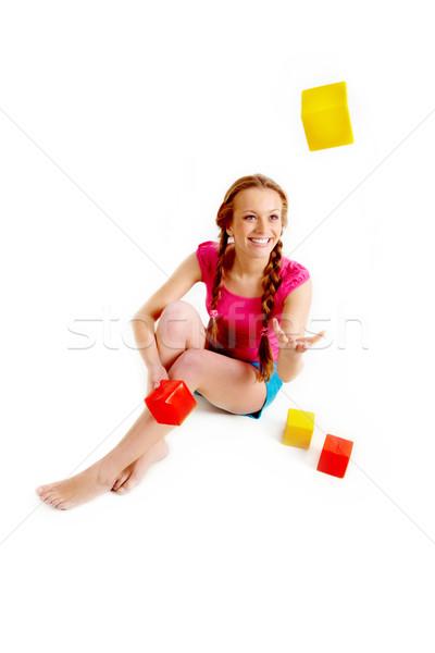 Spielen Steine Porträt glücklich junge Mädchen Sitzung Stock foto © pressmaster