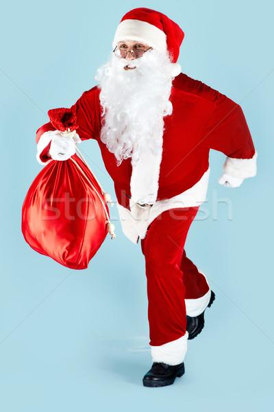 Acele Noel fotoğraf mutlu noel baba çalışma Stok fotoğraf © pressmaster