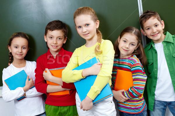 Stockfoto: Klasgenoten · portret · vijf · leerlingen · naar · camera