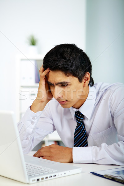 портрет бизнесмен глядя ноутбука экране Сток-фото © pressmaster