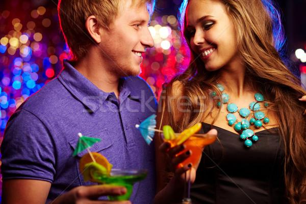 Szerelmi kép boldog pár szórakozás éjszakai klub Stock fotó © pressmaster