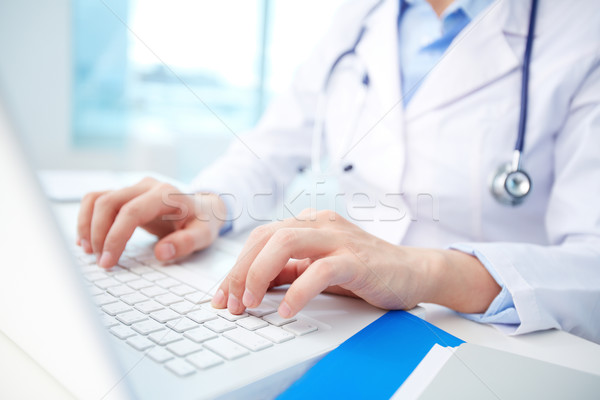 Stock photo: Clinician typing