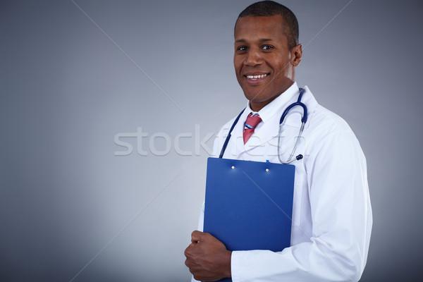 Clinician with clipboard Stock photo © pressmaster