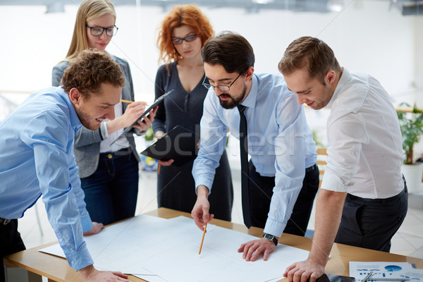 Looking at blueprint Stock photo © pressmaster