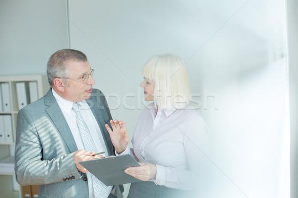 Dojrzały biznesmen kolega patrząc jeden inny Zdjęcia stock © pressmaster
