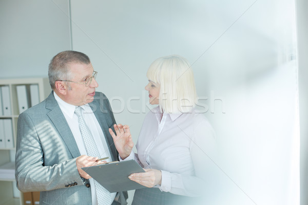 зрелый бизнесмен коллега глядя один другой Сток-фото © pressmaster