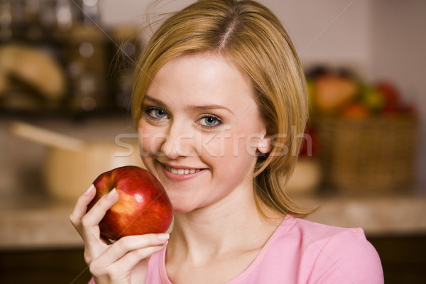 Girl with an apple Stock photo © pressmaster