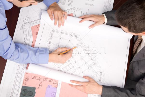 Métier au-dessus vue ingénieurs blueprints travaux Photo stock © pressmaster