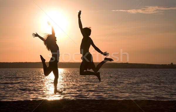Сток-фото: хорошие · счастливым · пару · прыжки · озеро